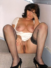 Older busty wife in stockings shows her..