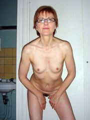 Older wife shows her small breasts and..