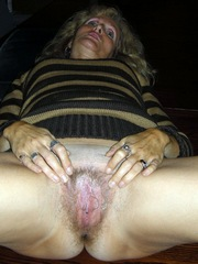 Mature blonde spreading her cunt pussy..