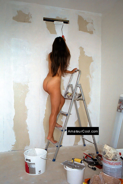 Tender girlfriend shows herself while painting the house