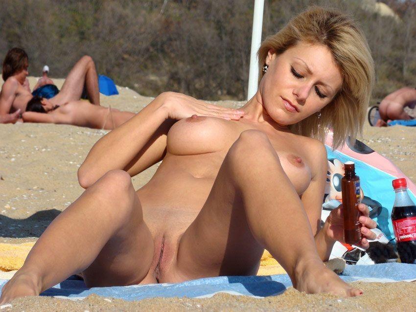 women taking sun baths on the nudist beautiful naked beach nudists