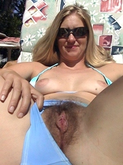 Milf shows her hairy pussy and breasts..